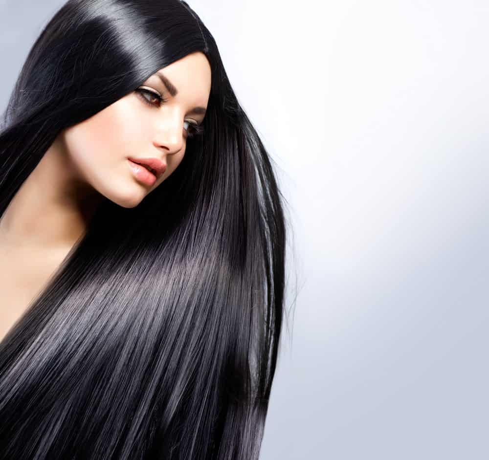 Woman with Long Black Straight and Tousled Shiny hair.