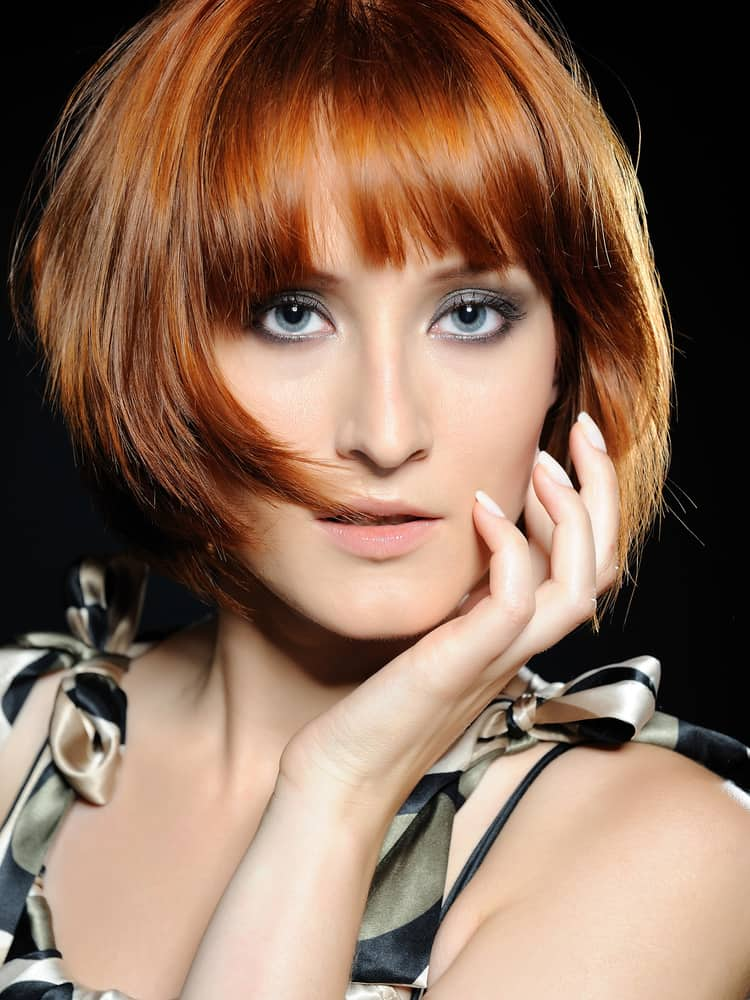 Woman With Voluminous Bob And Blunt Bang