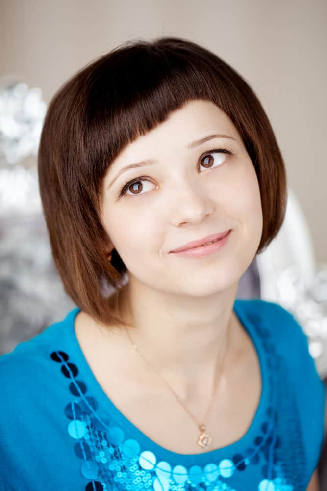 Woman With Short Bob And Uneven Bangs