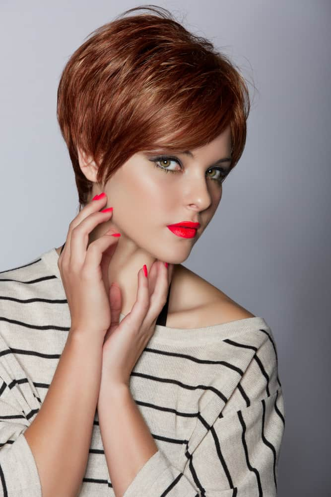 Woman With Layered Pixie Bob And Sweeping Bang