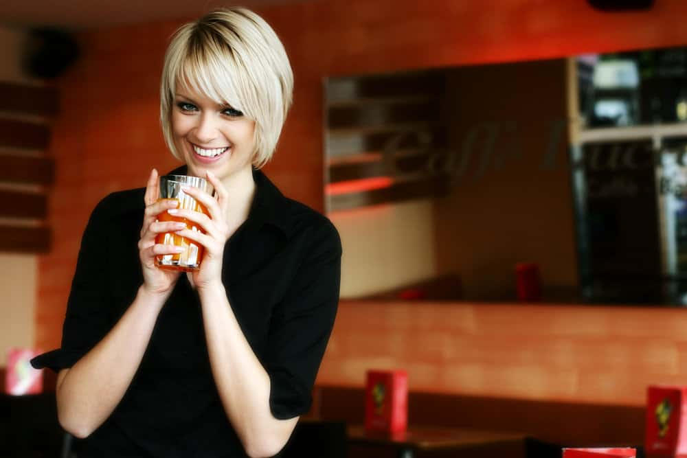 Woman with blonde hair in bob cut.