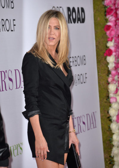 "Jennifer Aniston looking fabulous with her LONG STRAIGHT BLONDE hairstyle viewed from the side at the world premiere of ""Mother's Day""  2015."
