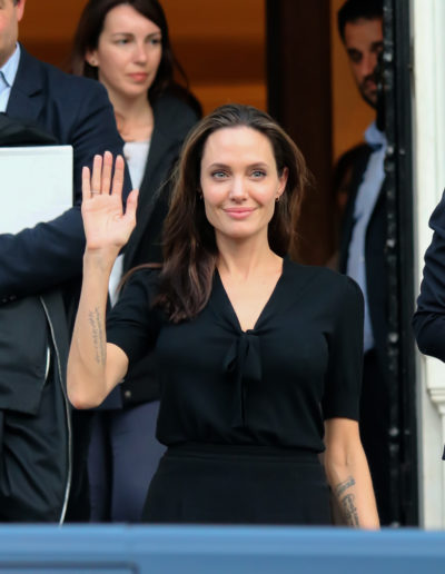 Angelina Jolie with her brunette long hair parted at the middle was seen leaving the Greek Prime minister's office in Athens 2016.