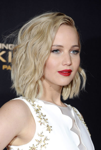 "Jennifer Lawrence with her hair brushed on one side at the  ""Hunger Games: Mocking Jay-part 2"" Premiere 2015."