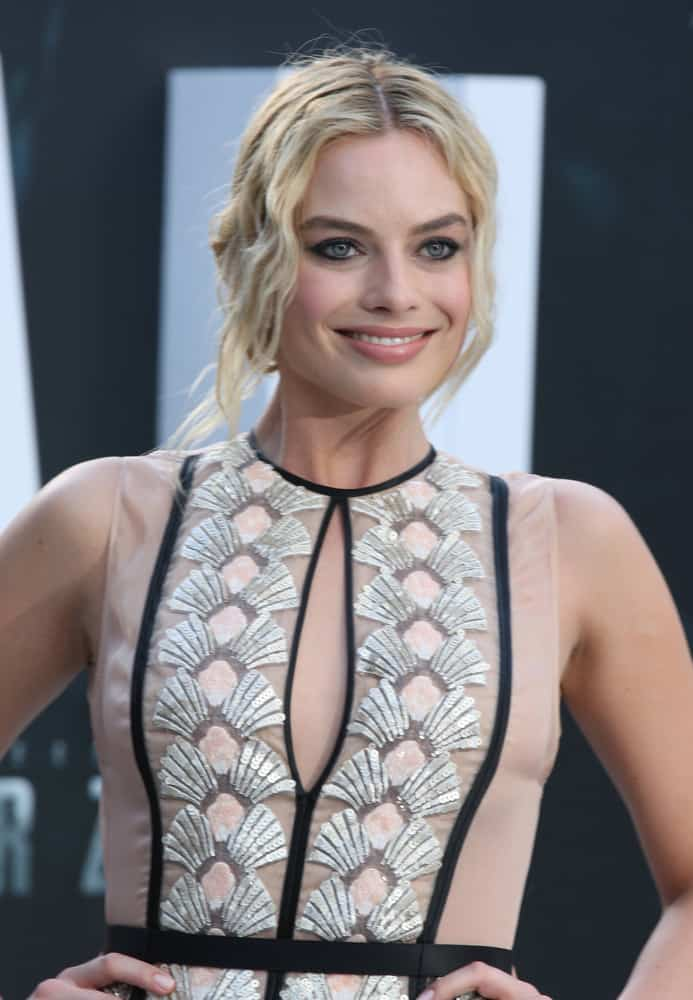 Margot Robbie with her blonde wavy upstyle hair at the European premiere of The Legend Of Tarzan 2016.