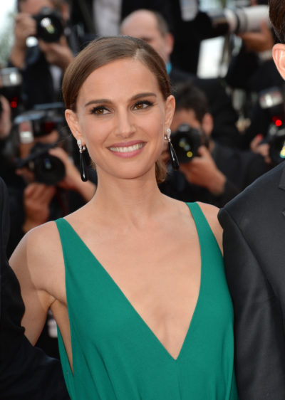 "Natalie Portman with her hair pulled into an upstyle hairstyle at the  gala premiere for ""Sicario"" 2015."