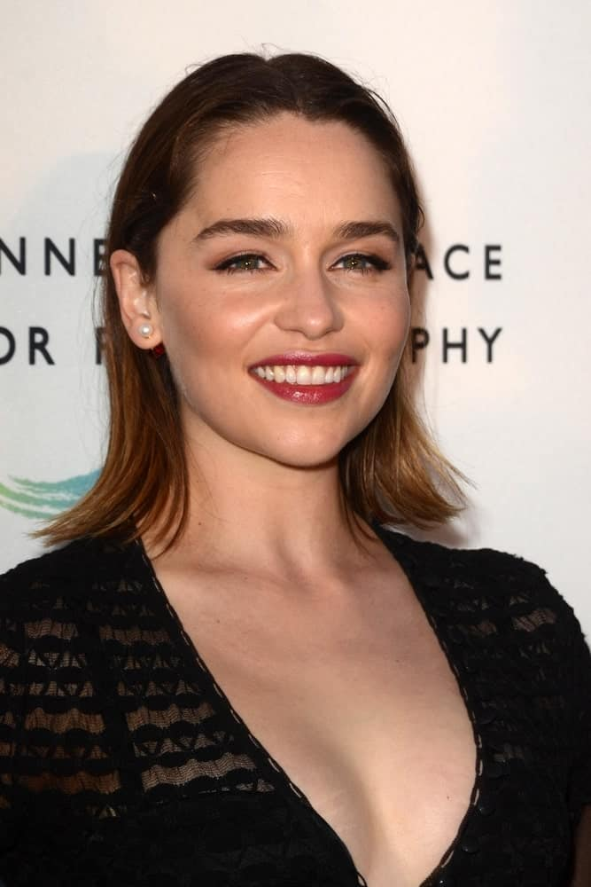 Emilia Clarke in her medium straight hair at the Annenberg Space for Photography 2016. She is looking really classy and sophisticated in her black see-thru dress and straight bob cut hair.