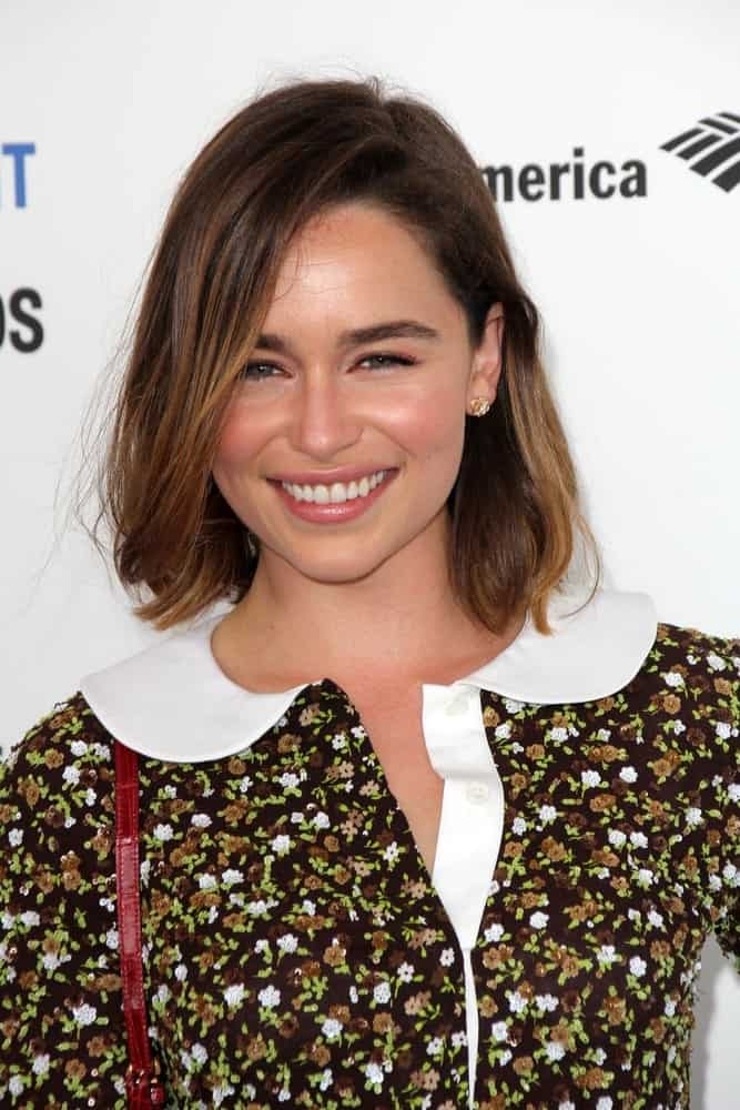 Emilia Clarke in her straight bob hairstyle at the 2016 Film Independent Spirit Awards. She looks quite youthful yet sophisticated with her collared floral dress and bob hairstyle.