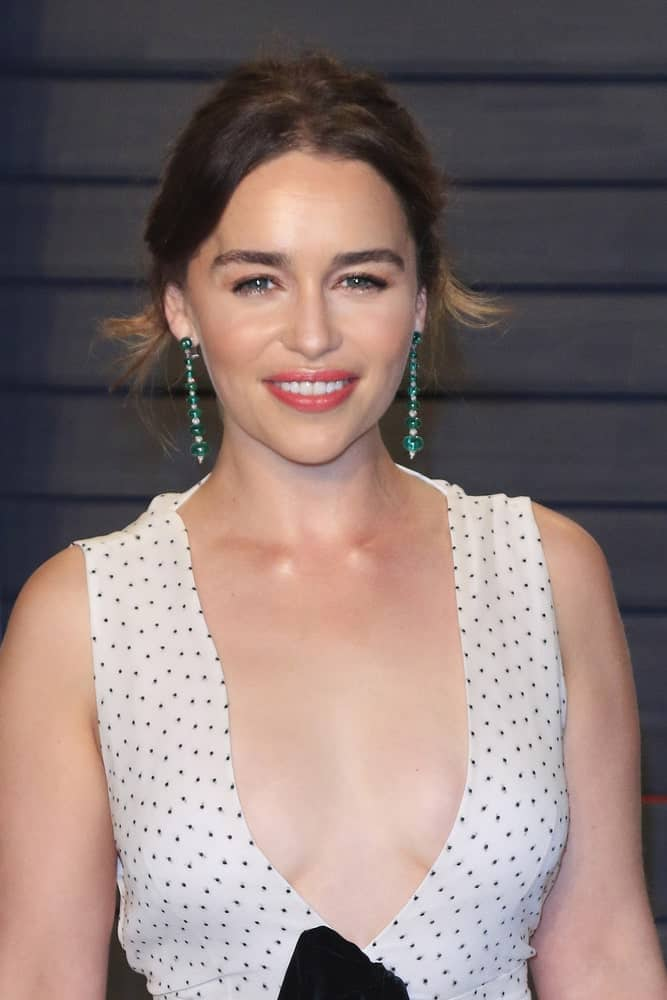 Emilia Clarke with her upstyle hair at the 2016 Vanity Fair Oscar Party. Emilia is looking very classy and elegant in her polka dots dress and up-style hair.