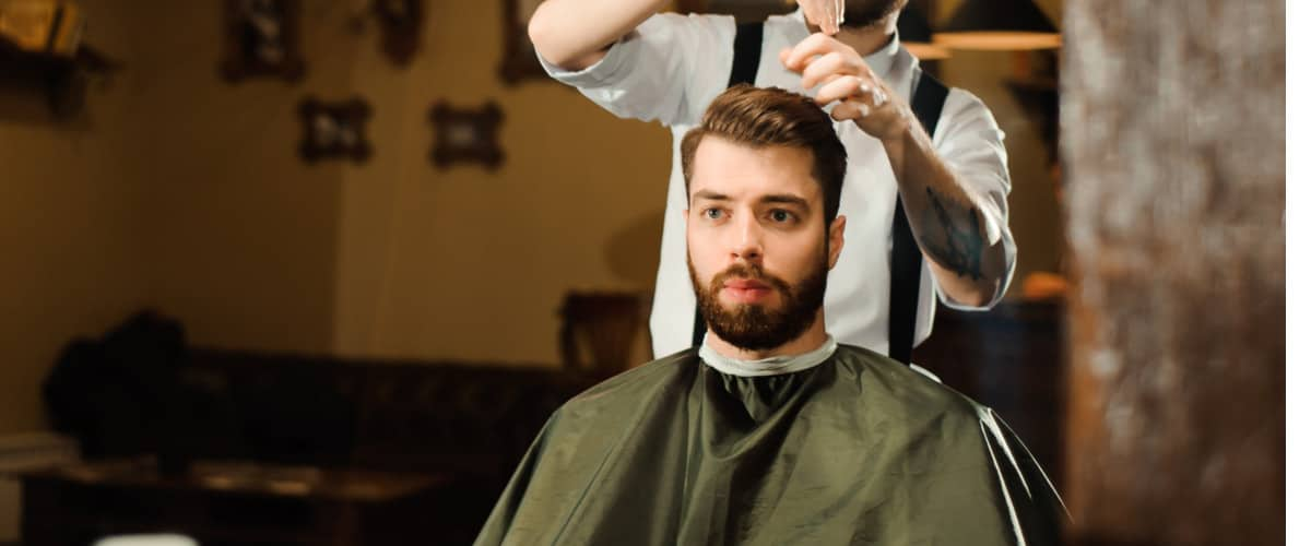 Man getting haircut at barber