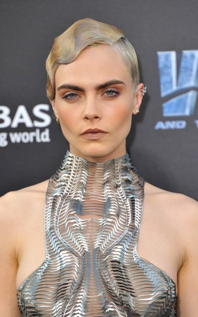 Cara Delevingne with very short hair.