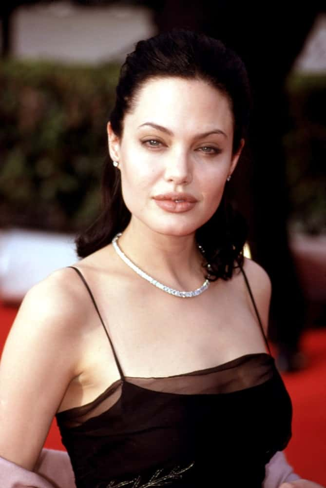 Angelina Jolie was at the Screen Actors Guild Awards way back in March of 2000. She came wearing a lovely black dress to pair with her raven half up hairstyle and sexy lips.