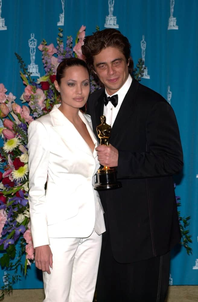 Actress Angelina Jolie and benicio Del Toro were at the 73rd Annual Academy Awards in Los Angeles on March 25, 2001. Jolie wore a smart casual white suit with her slicked back bun hairstyle.