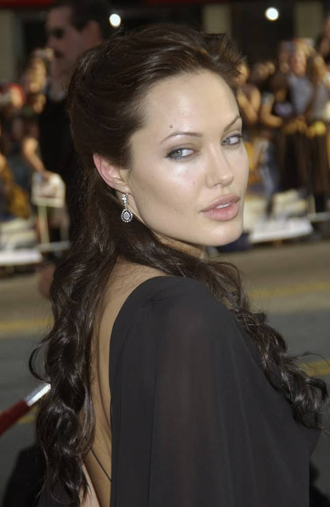 Actress Angelina Jolie wore a sexy black sheer dress with her raven half up hairstyle with waves and curls at the world premiere of her new movie Lara Croft Tomb Raider: The Cradle of Life, at Grauman's Chinese Theatre in Hollywood on July 21, 2003.