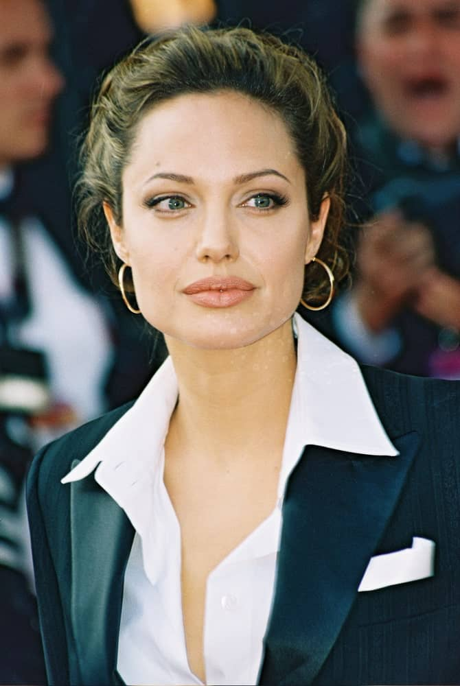 Actress Angelina Jolie attended the 'Shrek 2' premiere at the Le Palais de Festival during the 57th Cannes International Film Festival on May 15, 2004 in Cannes France. She was wearing a smart casual outfit to match her messy and loose upstyle hair with highlights.