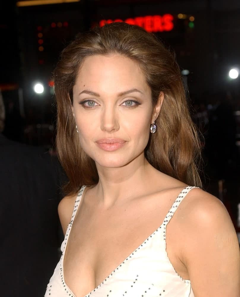 Angelina Jolie attended the premiere of SKY CAPTAIN AND THE WORLD OF TOMORROW on September 14, 2004 in Los Angeles. She was quite charming in her sexy white dress and tousled brushed-back brown hairstyle.