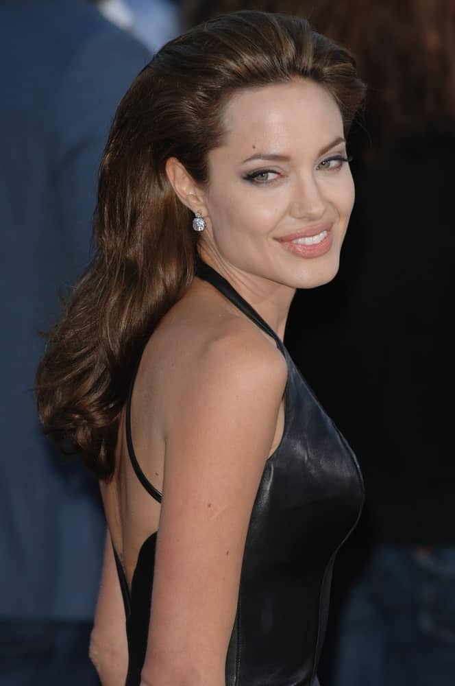 Actress Angelina Jolie went with a slicked back and tousled long hairstyle with her black leather dress at the world premiere of her new movie Mr & Mrs Smith on June 7, 2005 in Los Angeles, CA.