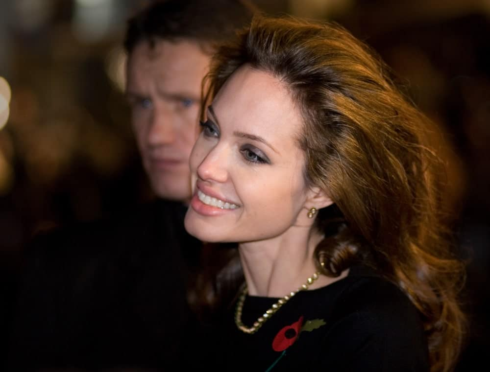 Angelina Jolie went with a vintage look to her long and brushed-back hair with curls at the tips at the European premiere of 'Beowulf' at the Vue Cinema on November 11, 2007 in London, England.