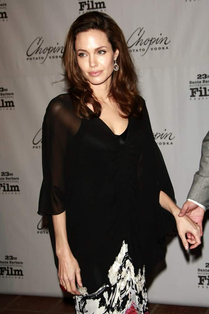 Angelina Jolie wore a black and white outfit to match her simple make-up and long wavy hairstyle that has long side-swept bangs at the 23rd Santa Barbara International Film Festival at the Arlington Theater in Santa Barbara, California on February 2, 2008.