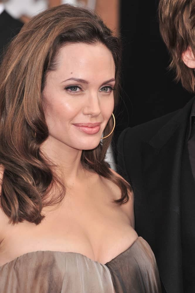 Angelina Jolie wore a sexy strapless dress to emphasize her long and wavy highlighted hairstyle loose on her shoulders at the 14th Annual Screen Actors Guild Awards at the Shrine Auditorium, Los Angeles, CA on January 27, 2008 in Los Angeles, CA.
