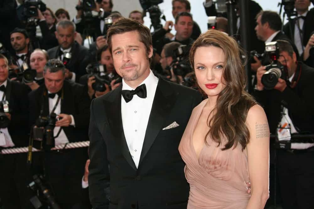 Angelina Jolie and Brad Pitt attended the 'Inglourious Basterds' Premiere at the Theatre Lumiere during the 62nd Annual Cannes Film Festival on May 20, 2009 in Cannes, France. Jolie was stunning in her beige dress and side-swept wavy hairstyle with layers and highlights.