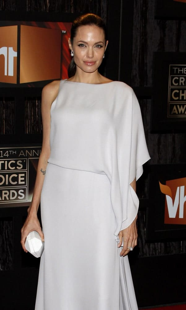 Angelina Jolie wore a slicked back ponytail hairstyle to match her carefree white dress at the VH1's 14th Annual Critics' Choice Awards held at the Santa Monica Civic Auditorium in Santa Monica, USA on January 8, 2009.