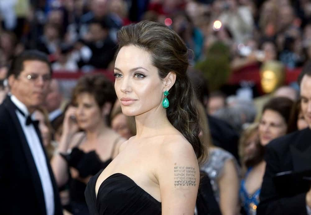 Angelina Jolie emphasized her Lorraine Schwartz earrings with a beautiful black strapless dress and a loose tousled half up hairstyle with highlights at the 81st Annual Academy Awards held at the Kodak Theatre in Los Angeles, CA on February 22, 2009.