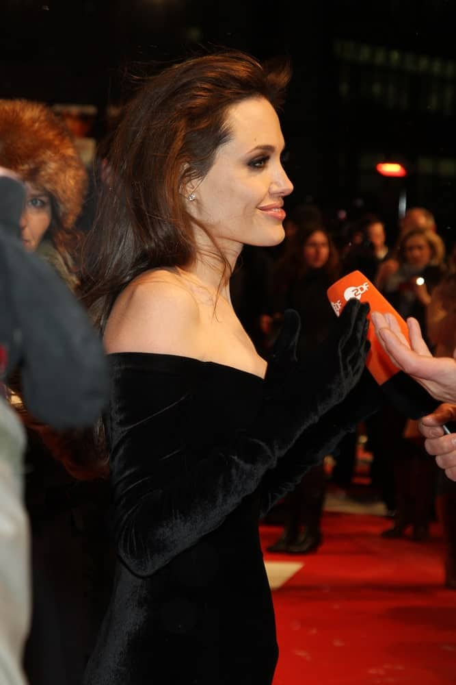 Angelina Jolie attended the European premiere of 'The Tourist' at the CineStar on December 14, 2010 in Berlin, Germany. She was the picture of sophistication in her charming black velvet dress and long brushed back hairstyle with a slight tousle.