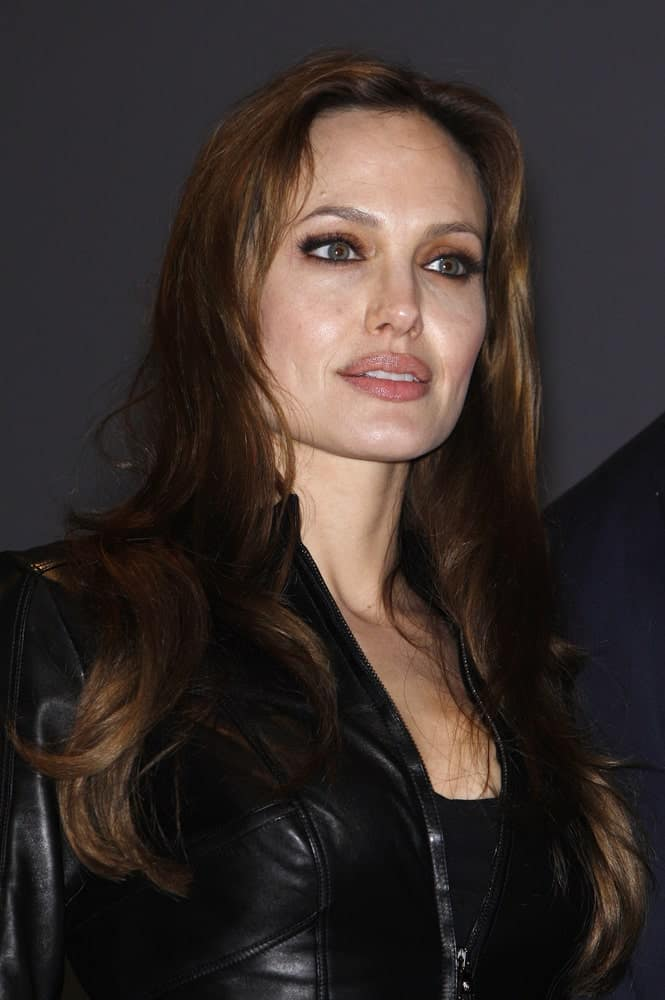 Angelina Jolie looked cool in her edgy black leather jacket and long, loose wavy brunette hairstyle on her shoulders while promoting the movie 'Salt' on Day 1 of Comicon in San Diego, California on July 22, 2010.