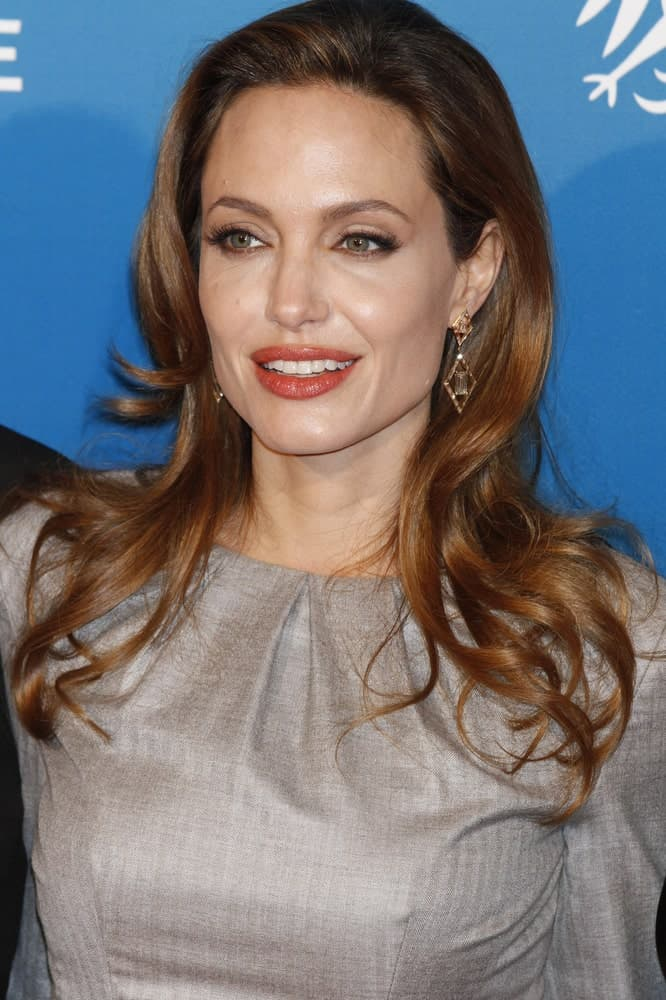 Angelina Jolie was at the Cinema For Peace Gala during day five of the 62nd International Film Festival on February 13, 2012 in Berlin, Germany. She was elegant in her simple gray outfit and shoulder-length brunette hairstyle with layers and curls at the tips.