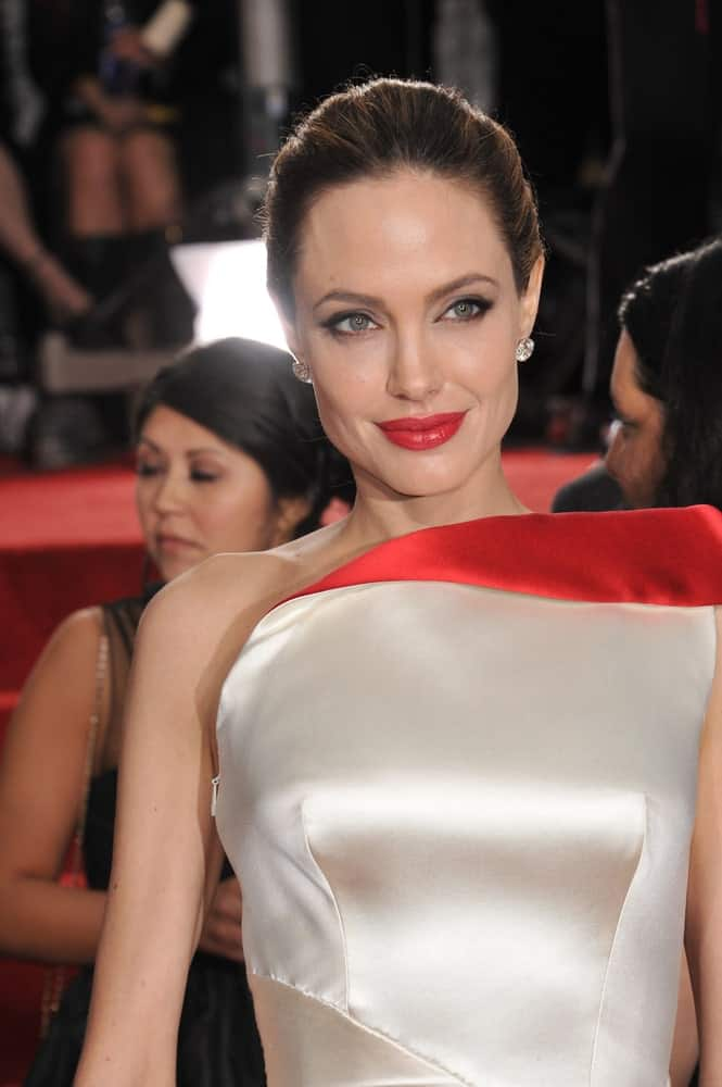 Angelina Jolie was quite the lovely picture of sophistication in her white dress and slick upstyle with highlights at the 69th Golden Globe Awards at the Beverly Hilton Hotel on January 15, 2012 in Beverly Hills, CA.
