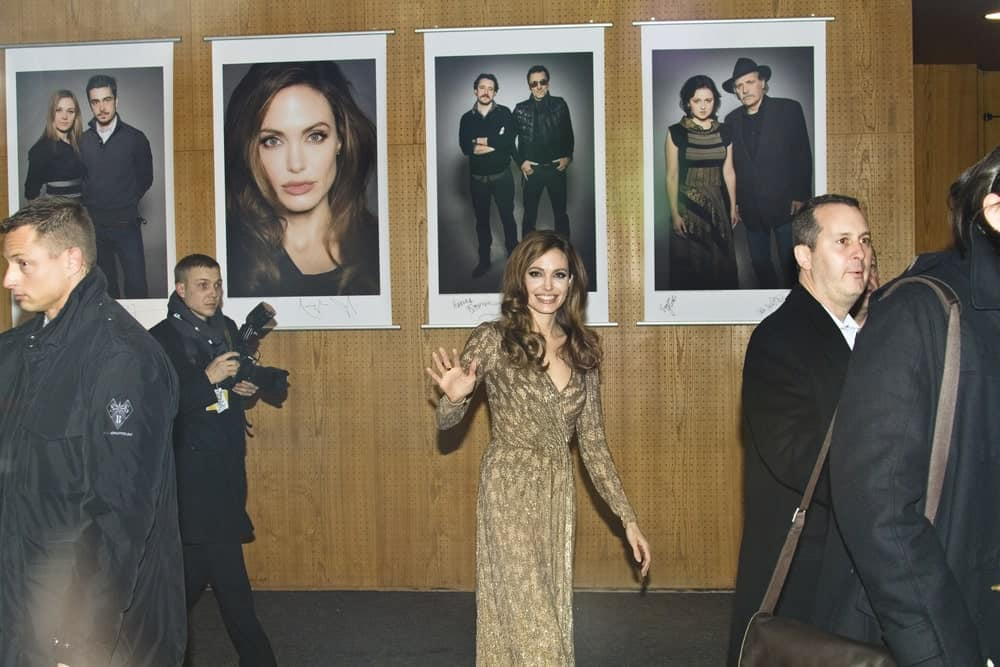 Angelina Jolie attended the 'In The Land Of Blood And Honey' during of the 62 Berlin Festival at the Haus der Berliner Festspiele on Feb. 11, 2012 in Berlin, Germany. She was quite lovely in her golden dress and long dark brown hairstyle with curls at the tips.