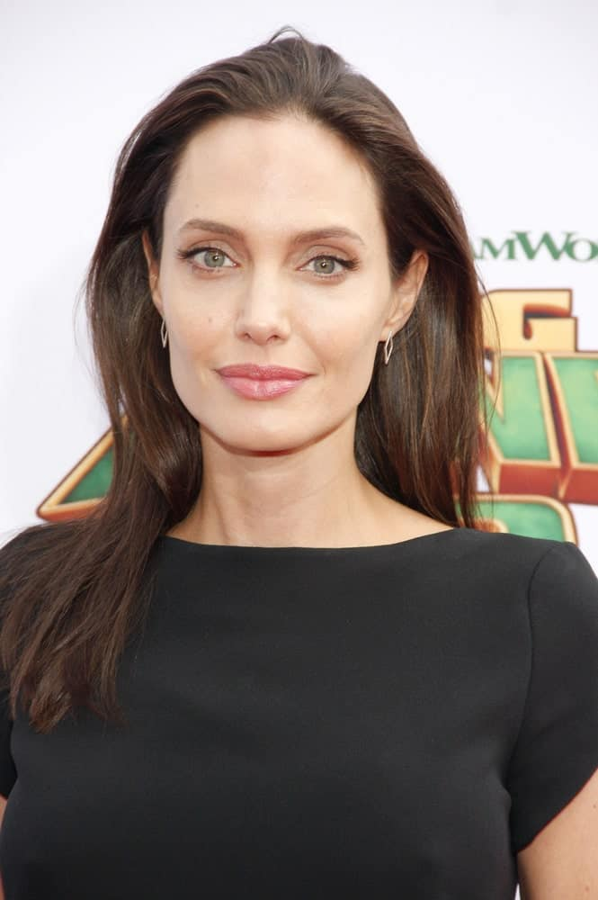 Angelina Jolie wore a simple black dress that complemented her medium-length hairstyle that has subtle highlights loose on her shoulder at the Los Angeles premiere of 'Kung Fu Panda 3' held at the TCL Chinese Theater in Hollywood, USA on January 16, 2016.
