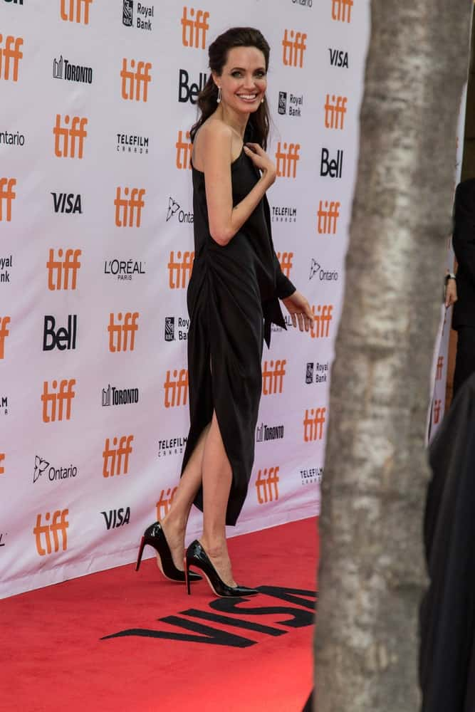On September 11, 2017, Angelina Jolie greeted the fans and walked the red carpet at the premiere of First They Killed My Father at the Toronto Film Festival. She wowed everyone with her charming black dress, shoes and her half up hairstyle.