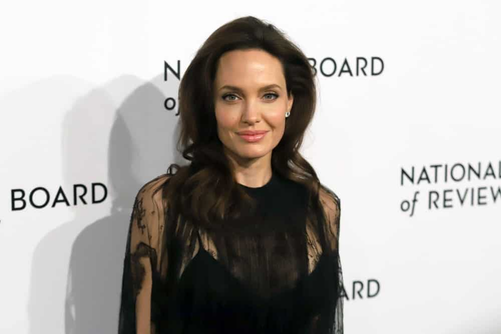 Angelina Jolie attended the National Board of Review Awards at Cipriani on January 9, 2018, in New York. She wore a black sheer dress that she matched with her loose and tousled brunette hairstyle with slight waves at the tips.