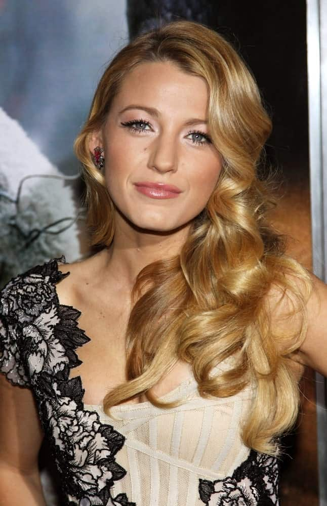 Blake Lively looked quite stunning in her detailed black and white dress and side-swept curly blond hair at the