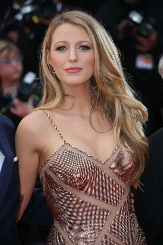 Blake Lively's stunning smokey eyes paired well with her tousled side-swept beach waves as well as her sexy sequined dress at the 2016 'Cafe Society' premiere in Cannes, France.