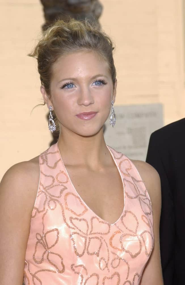 Brittany Snow was at the 2003 Primetime Creative Arts Emmy Awards at the Shrine Auditorium, Los Angeles on September 13, 2003. She wore a charming peach dress to pair with her elegant curly sandy blonde bun hairstyle.