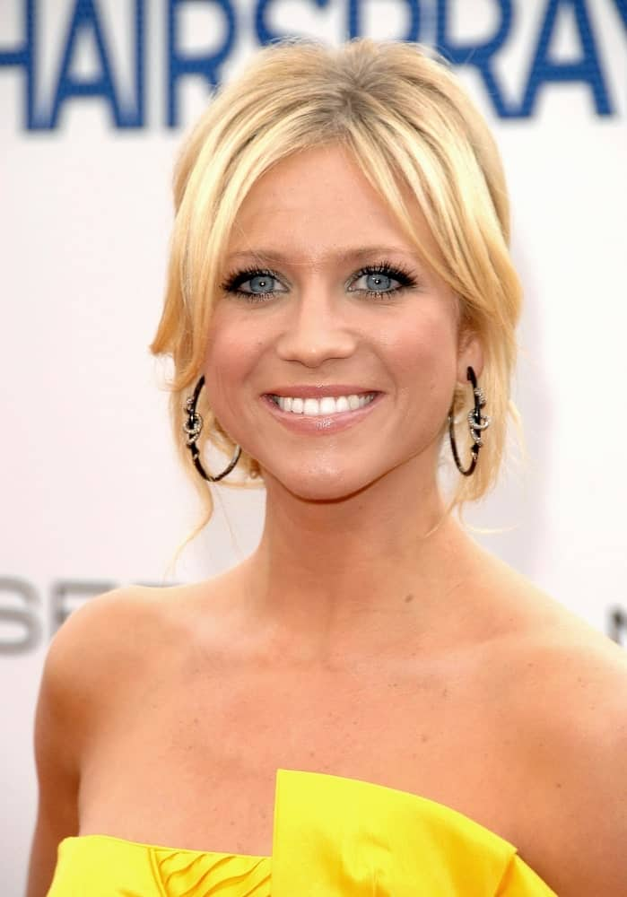Brittany Snow attended the Los Angeles Premiere of Hairspray at the Mann's Village Theatre in Westwood, Los Angeles, CA on July 10, 2007. SHe was seen wearing a yellow strapless dress to pair with her messy bun hairstyle that has loose bangs and tendrils.