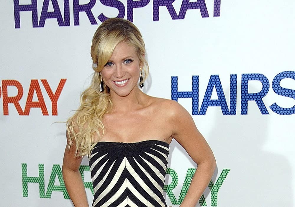 Brittany Snow was at the NY Premiere of Hairspray at The Ziegfeld Theatre, New York, NY on July 16, 2007. She paired her patterned strapless dress with a long ponytail hairstyle that has curls, highlights and layers.