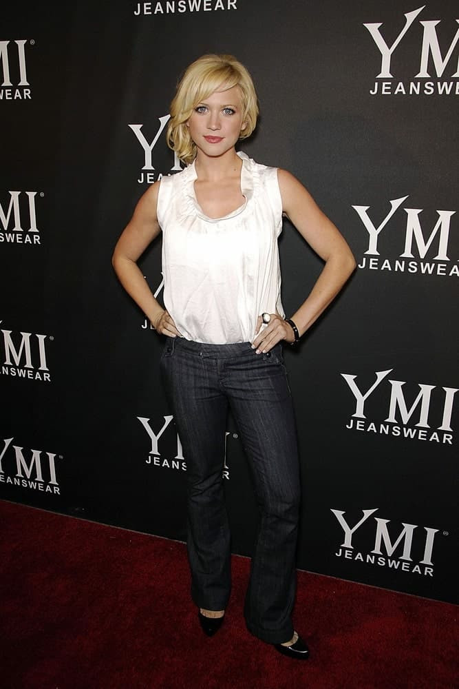 Brittany Snow attended the YMI Jeanswear Fashion Show at the Boulevard3 in Los Angeles, CA on October 09, 2007. She wore a casual blouse outfit with her messy blonde ponytail hairstyle that has loose bangs and tendrils.