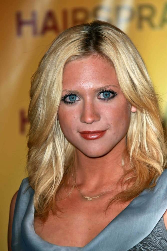 Brittany Snow was at the ShoWest 2007 Photocall for Hairspray in Paris Hotel, Las Vegas, NV on March 14, 2007. She paired her gray dress with her bronzed skin and shoulder-length layered blonde hairstyle with a slight tousle.