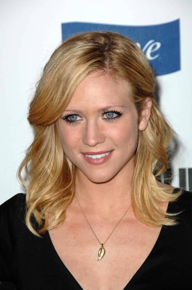 Brittany Snow was at the 2008 Glamour Reel Moments Gala in Directors Guild of America, Los Angeles, CA on October 14, 2008. She elevated her simple black dress with a shoulder-length tousled and layered hairstyle.