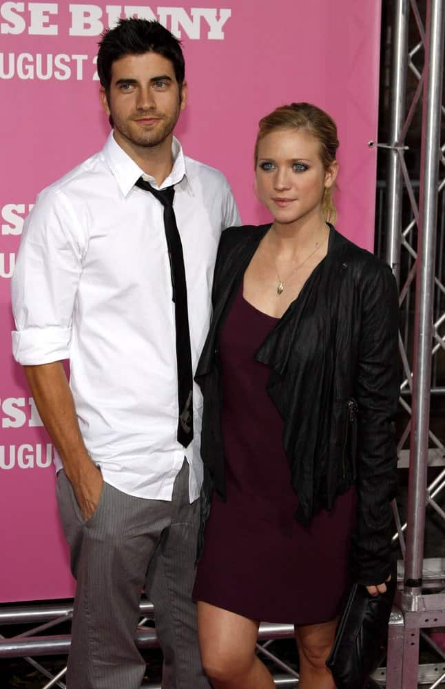 Brittany Snow attended the Los Angeles premiere of 'The House Bunny' held at the Mann Village Theater in Westwood on August 20, 2008. She wore a dress and a black leather jacket with her highlighted blonde ponytail hairstyle with a slick finish.
