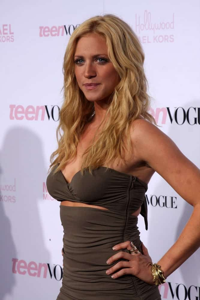 Brittany Snow was at the 8th Teen Vogue Young Hollywood Party - Red Carpet at Paramount Studios on October 1, 2010 in Los Angeles, CA. She was stunning in a green dress with her long and curly layered snady blonde hairstyle that is loose and tousled.