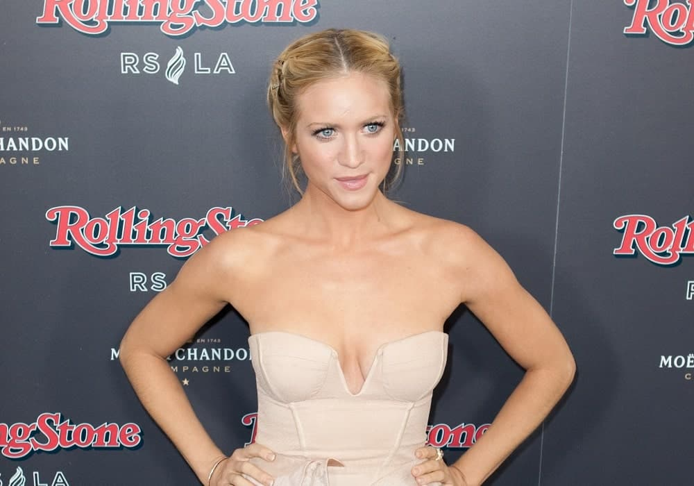 Brittany Snow was at the 2010 American Music Awards Rolling Stone Magazine VIP After Party at Rolling Stone Restaurant and Lounge on November 21, 2010 in Hollywood, CA. She wore a lovely beige dress that she paired with her pinned and braided blonde upstyle.