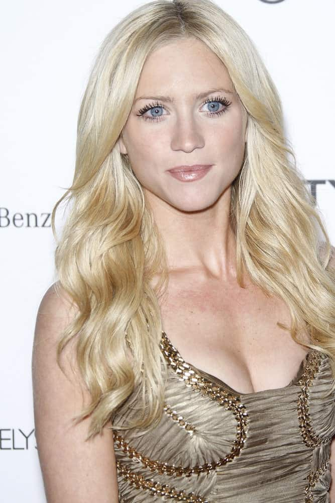 Brittany Snow was at the Art Of Elysium 'Heaven' Gala 2011 at The California Science Center Exposition Park in Los Angeles, CA on January 15, 2011. SHe paired her detailed dress with a long blonde wavy and layered hairstyle.