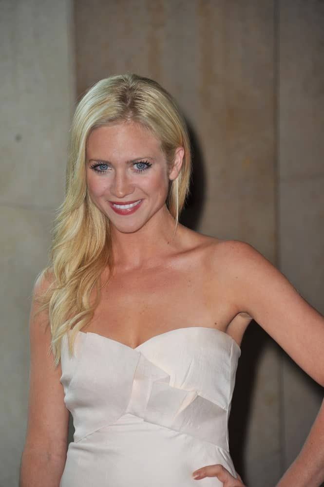 Brittany Snow was at the Women in Film 2011 Crystal + Lucy Awards at the Beverly Hilton Hotel on June 16, 2011. SHe paired her sexy white dress with a long blonde side-swept hairstyle with layers and waves.