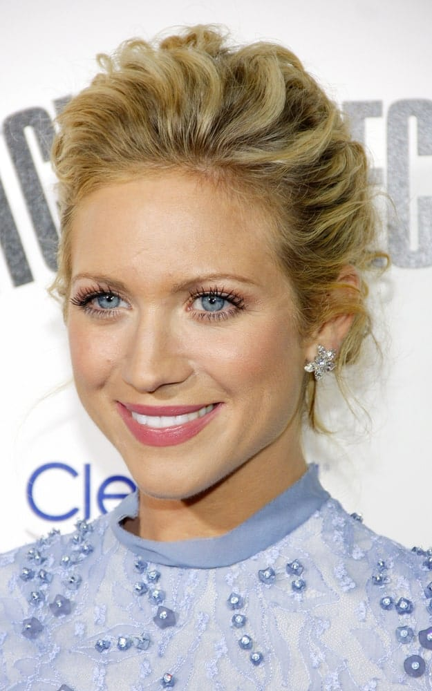 Brittany Snow was at the Los Angeles premiere of 'Pitch Perfect' held at the ArcLight Cinemas in Hollywood on September 24, 2012. She wore a lovely dress to pair with her sandy blonde messy and tousled bun hairstyle.