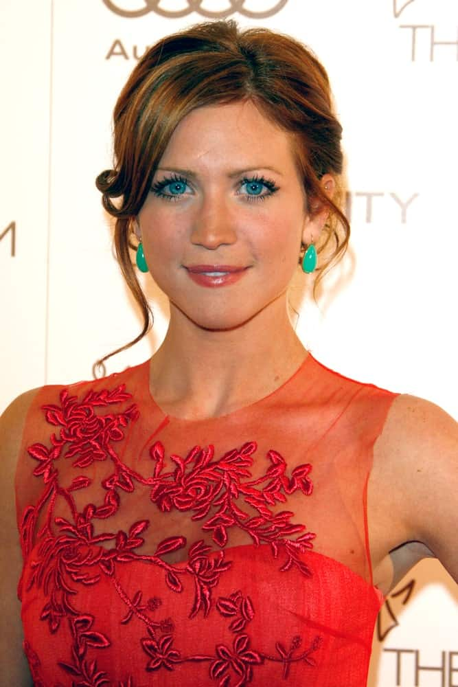 Brittany Snow was at the 2012 Art of Elysium Heaven Gala at the Union Station on January 14, 2012 in Los Angeles, CA. She paired her sheer red dress with a messy and highlighted brunette bun hairstyle.